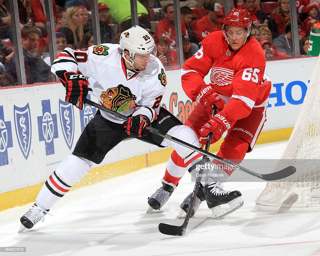 <a gi-track='captionPersonalityLinkClicked' href=/galleries/search?phrase=Brandon+Saad&family=editorial&specificpeople=7128385 ng-click='$event.stopPropagation()'>Brandon Saad</a> #20 of the Chicago Blackhawks crashes the net as Danny DeKeyser #65 of the Detroit Red Wings defends during an NHL game on January 22, 2014 at Joe Louis Arena in Detroit, Michigan.