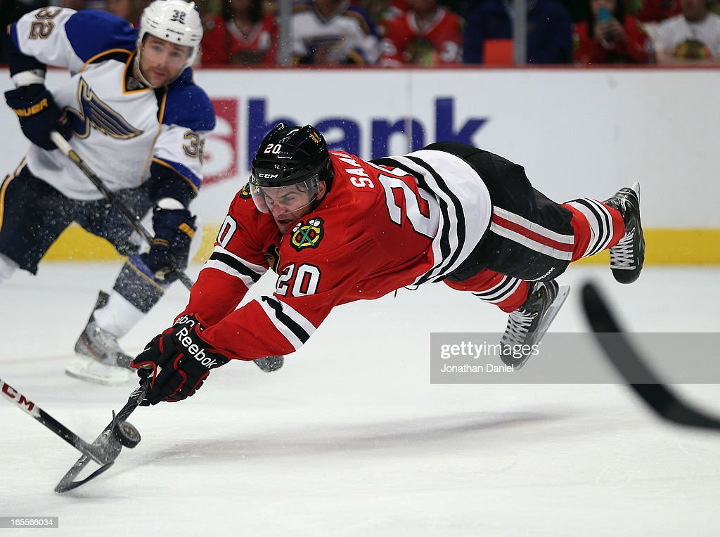 Brandon Saad #20 of the Chicago Blackhawks dives for the puck against the St. Louis Blues at the United Center on April 4, 2013 in Chicago, Illinois. The Blues defeated the Blackhawks 4-3 in a shootout.