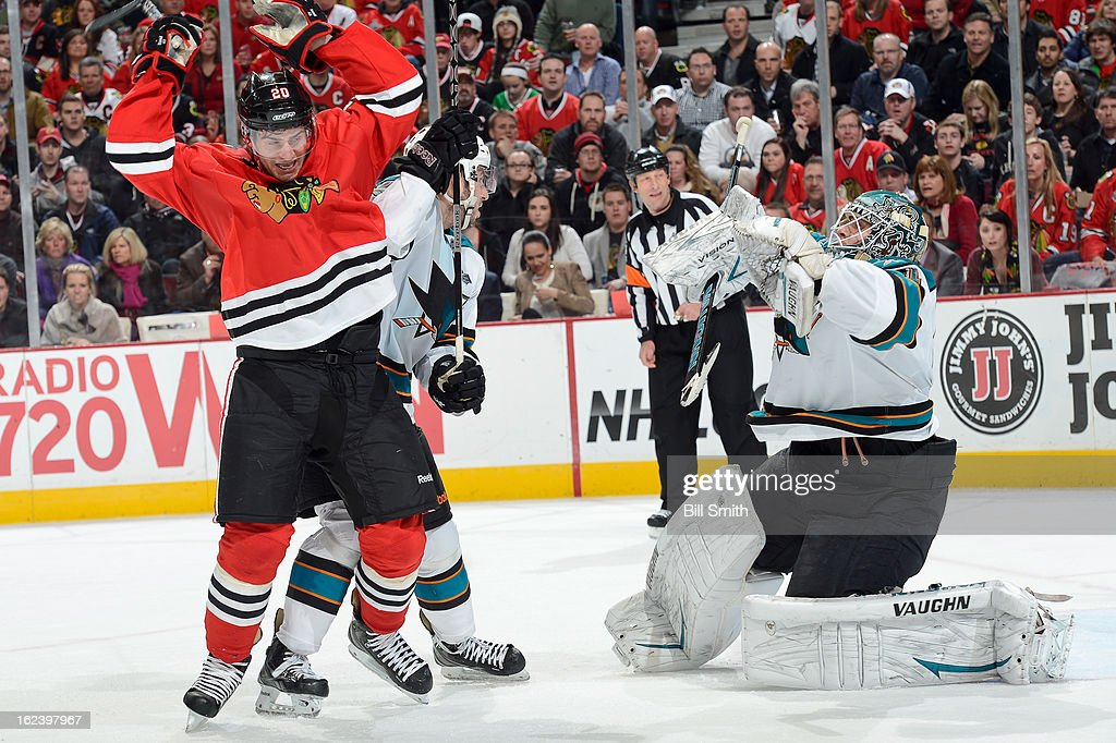 Brandon Saad #20 of the Chicago Blackhawks fights for position in front of goalie <a gi-track='captionPersonalityLinkClicked' href=/galleries/search?phrase=Antti+Niemi&family=editorial&specificpeople=213913 ng-click='$event.stopPropagation()'>Antti Niemi</a> #31 of the San Jose Sharks during the NHL game on February 22, 2013 at the United Center in Chicago, Illinois.