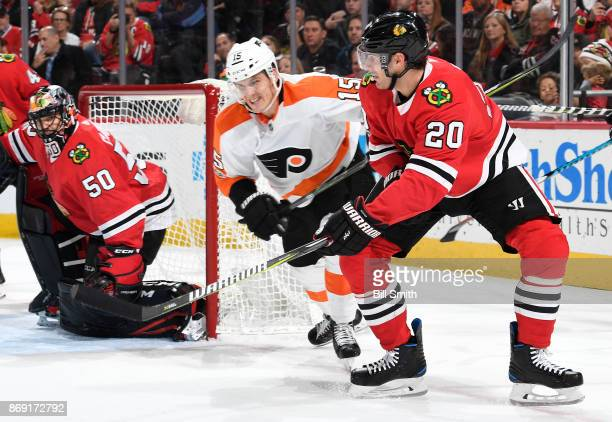 Brandon Saad of the Chicago Blackhawks hits the puck past Jori Lehtera of the Philadelphia Flyers in the second period at the United Center on...
