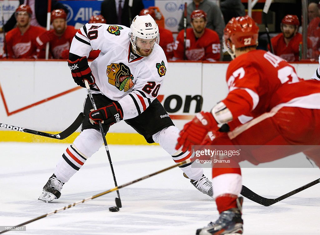 <a gi-track='captionPersonalityLinkClicked' href=/galleries/search?phrase=Brandon+Saad&family=editorial&specificpeople=7128385 ng-click='$event.stopPropagation()'>Brandon Saad</a> #20 of the Chicago Blackhawks looks to get around Kyle Quincey #27 of the Detroit Red Wings during the third period in Game Six of the Western Conference Semifinals during the 2013 NHL Stanley Cup Playoffs at Joe Louis Arena on May 27, 2013 in Detroit, Michigan. Chicago won the game 4-3 to tie the series 3-3.