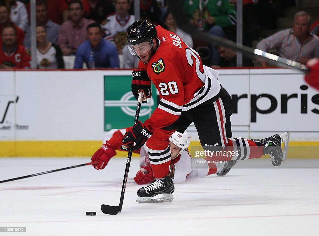 <a gi-track='captionPersonalityLinkClicked' href=/galleries/search?phrase=Brandon+Saad&family=editorial&specificpeople=7128385 ng-click='$event.stopPropagation()'>Brandon Saad</a> #20 of the Chicago Blackhawks moves against the Detroit Red Wings in Game One of the Western Conference Semifinals during the 2013 NHL Stanley Cup Playoffs at the United Center on May 15, 2013 in Chicago, Illinois. The Blackhawks defeated the Red Wings 4-1.