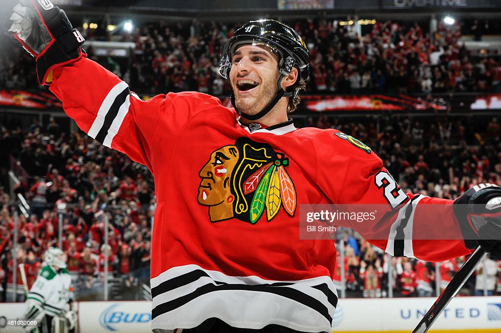 <a gi-track='captionPersonalityLinkClicked' href=/galleries/search?phrase=Brandon+Saad&family=editorial&specificpeople=7128385 ng-click='$event.stopPropagation()'>Brandon Saad</a> #20 of the Chicago Blackhawks reacts after Patrick Sharp #10 (not pictured) scored the game winning goal against the Dallas Stars in overtime of the NHL game at the United Center on January 4, 2015 in Chicago, Illinois.