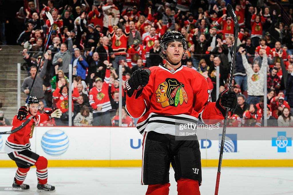 <a gi-track='captionPersonalityLinkClicked' href=/galleries/search?phrase=Brandon+Saad&family=editorial&specificpeople=7128385 ng-click='$event.stopPropagation()'>Brandon Saad</a> #20 of the Chicago Blackhawks reacts after scoring against the Detroit Red Wings in the second period, as <a gi-track='captionPersonalityLinkClicked' href=/galleries/search?phrase=Jonathan+Toews&family=editorial&specificpeople=537799 ng-click='$event.stopPropagation()'>Jonathan Toews</a> #19 celebrates in the background, during the NHL game at the United Center on February 18, 2015 in Chicago, Illinois.