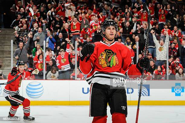 Brandon Saad of the Chicago Blackhawks reacts after scoring against the Detroit Red Wings in the second period as Jonathan Toews celebrates in the...