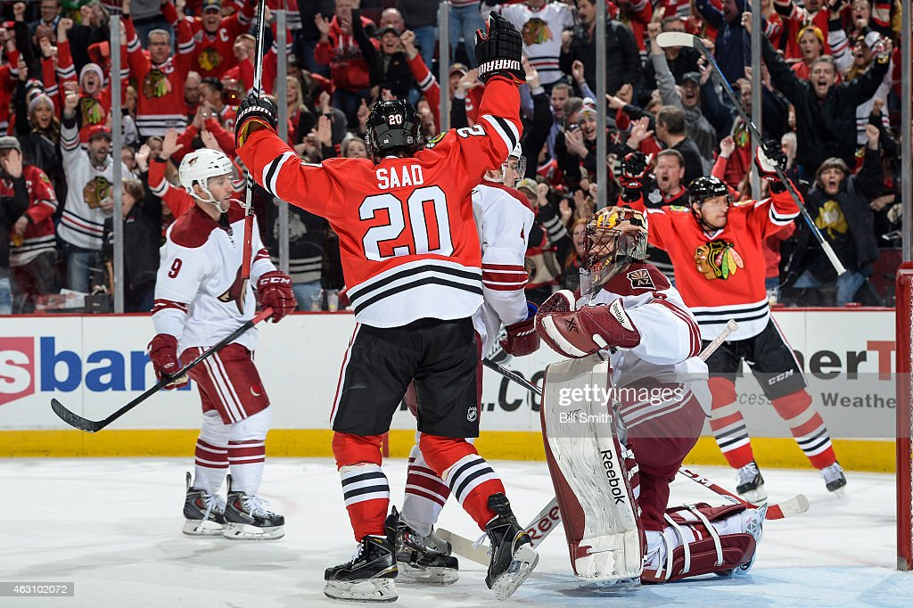<a gi-track='captionPersonalityLinkClicked' href=/galleries/search?phrase=Brandon+Saad&family=editorial&specificpeople=7128385 ng-click='$event.stopPropagation()'>Brandon Saad</a> #20 of the Chicago Blackhawks reacts next to goalie <a gi-track='captionPersonalityLinkClicked' href=/galleries/search?phrase=Mike+Smith+-+Ice+Hockey+Player&family=editorial&specificpeople=213785 ng-click='$event.stopPropagation()'>Mike Smith</a> #41 of the Arizona Coyotes as <a gi-track='captionPersonalityLinkClicked' href=/galleries/search?phrase=Marian+Hossa&family=editorial&specificpeople=202233 ng-click='$event.stopPropagation()'>Marian Hossa</a> #81 celebrates in the background, after scoring his second goal of the game during the NHL game at the United Center on February 9, 2015 in Chicago, Illinois.