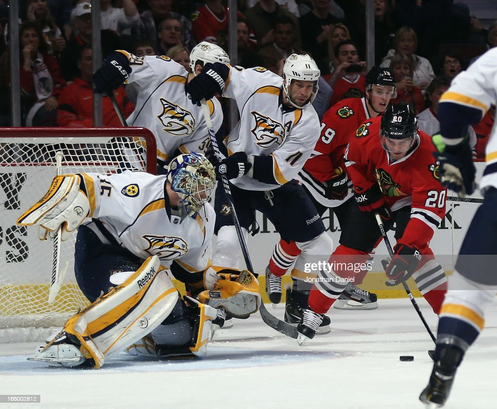 <a gi-track='captionPersonalityLinkClicked' href=/galleries/search?phrase=Brandon+Saad&family=editorial&specificpeople=7128385 ng-click='$event.stopPropagation()'>Brandon Saad</a> #20 of the Chicago Blackhawks scores a goal against <a gi-track='captionPersonalityLinkClicked' href=/galleries/search?phrase=Pekka+Rinne&family=editorial&specificpeople=2118342 ng-click='$event.stopPropagation()'>Pekka Rinne</a> #35 of the Nashville Predators at the United Center on April 7, 2013 in Chicago, Illinois. The Blackhawks defeated the Predators 5-3.