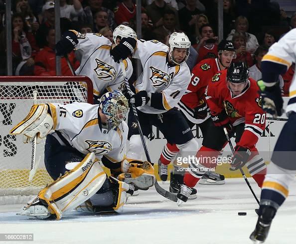 Brandon Saad of the Chicago Blackhawks scores a goal against Pekka Rinne of the Nashville Predators at the United Center on April 7 2013 in Chicago...