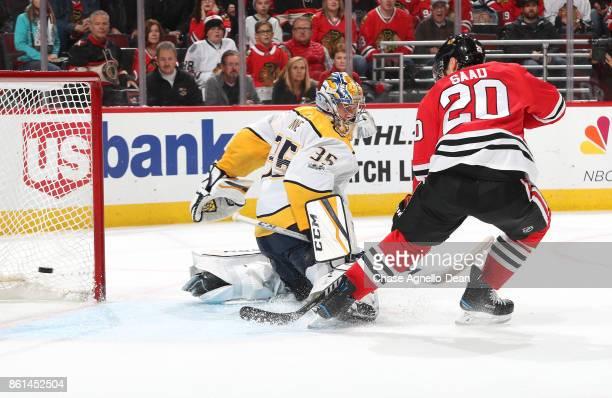 Brandon Saad of the Chicago Blackhawks scores the game winning goal in overtime against goalie Pekka Rinne of the Nashville Predators at the United...