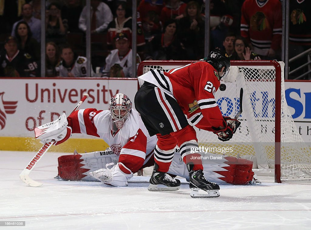 <a gi-track='captionPersonalityLinkClicked' href=/galleries/search?phrase=Brandon+Saad&family=editorial&specificpeople=7128385 ng-click='$event.stopPropagation()'>Brandon Saad</a> #20 of the Chicago Blackhawks scores the game-winning goal in a shootout against <a gi-track='captionPersonalityLinkClicked' href=/galleries/search?phrase=Jimmy+Howard&family=editorial&specificpeople=2118637 ng-click='$event.stopPropagation()'>Jimmy Howard</a> #35 of the Detroit Red Wings at the United Center on April 12, 2013 in Chicago, Illinois. The Blackhawks defeated the Redwings 3-2 in a shootout.