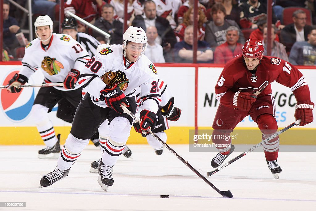 Brandon Saad #20 of the Chicago Blackhawks skates with the puck past <a gi-track='captionPersonalityLinkClicked' href=/galleries/search?phrase=Boyd+Gordon&family=editorial&specificpeople=209395 ng-click='$event.stopPropagation()'>Boyd Gordon</a> #15 of the Phoenix Coyotes during the NHL game at Jobing.com Arena on February 7, 2013 in Glendale, Arizona. The Blackhawks defeated the Coyotes 6-2.