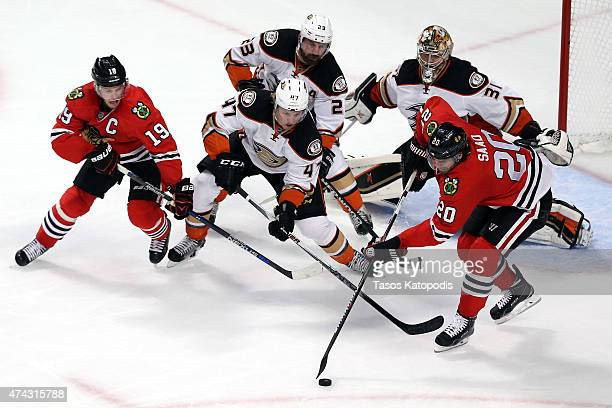 Brandon Saad of the Chicago Blackhawks tries to control the puck as Hampus Lindholm of the Anaheim Ducks defends in Game Three of the Western...
