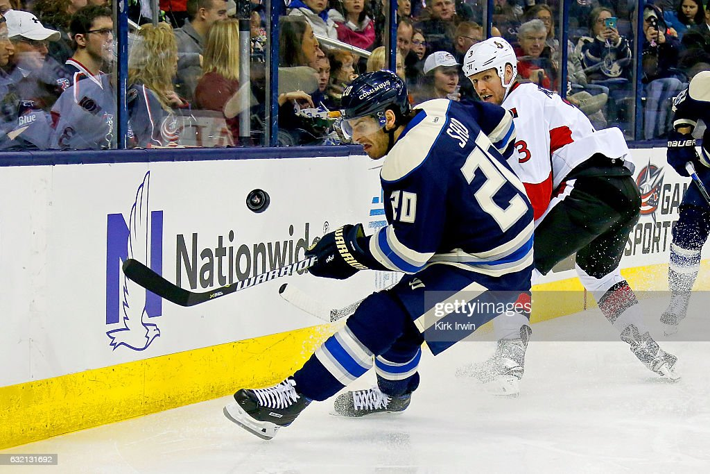 Brandon Saad #20 of the Columbus Blue Jackets beats Marc Methot #3 of the Ottawa Senators to the loose puck during the second period on January 19, 2017 at Nationwide Arena in Columbus, Ohio. Ottawa defeated Columbus 2-0.