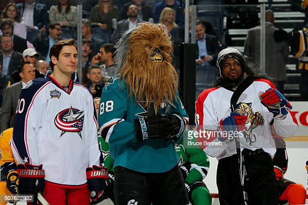 Brandon Saad of the Columbus Blue Jackets Brent Burns of the San Jose Sharks and PK Subban of the Montreal Canadiens look on in the DraftKings NHL...