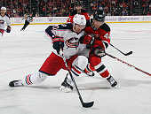 Brandon Saad of the Columbus Blue Jackets is checked by Eric Gelinas of the New Jersey Devils at the Prudential Center on October 27 2015 in Newark...