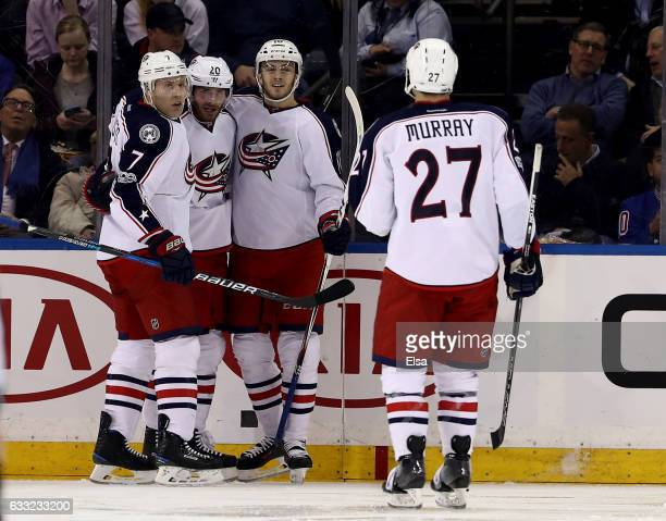 Brandon Saad of the Columbus Blue Jackets is congratulated by teammates Jack JohnsonAlexander Wennberg and Ryan Murray after Saad scored in the...