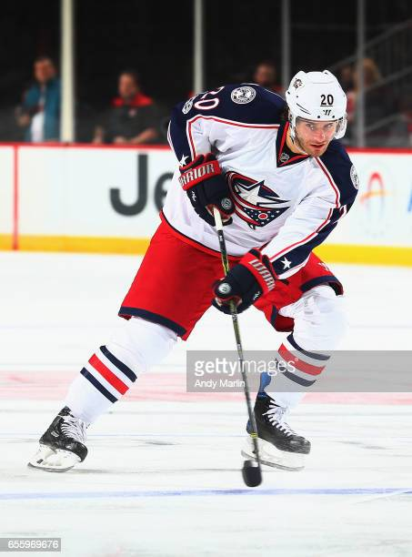 Brandon Saad of the Columbus Blue Jackets plays the puck against the New Jersey Devils during the game at Prudential Center on March 19 2017 in...