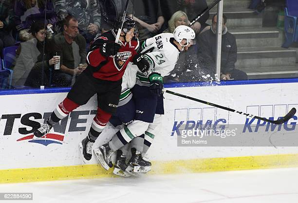 Brandon Schulohaus of the Seattle Thunderbirds checks Jack Flaman of the Vancouver Giants during the first period of their WHL game at the Langley...