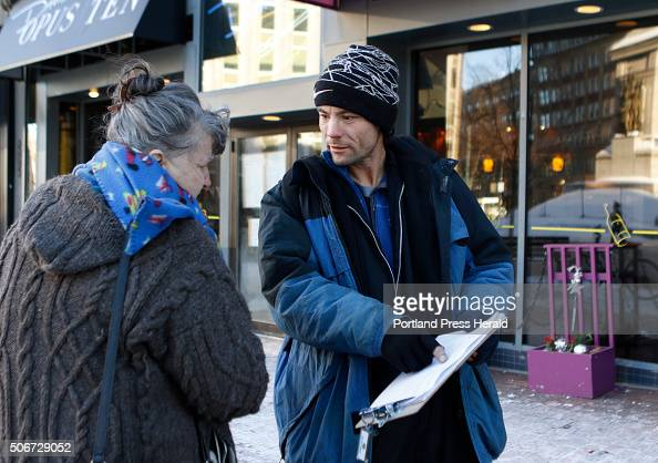 Brandon Scott right speaks with Joyce Lorraine as he works to collect signatures on a petition regarding a casino referendum Thursday Jan 21 2016 in...