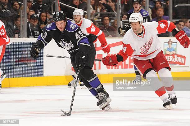 Brandon Segal of the Los Angeles Kings skates with the puck against Todd Bertuzzi of the Detroit Red Wings on January 7 2010 at Staples Center in Los...