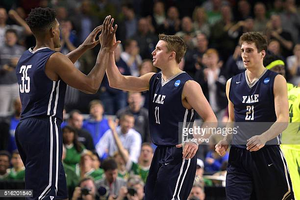 Brandon Sherrod highfives Makai Mason of the Yale Bulldogs near the end of their game against the Baylor Bears during the first round of the 2016...
