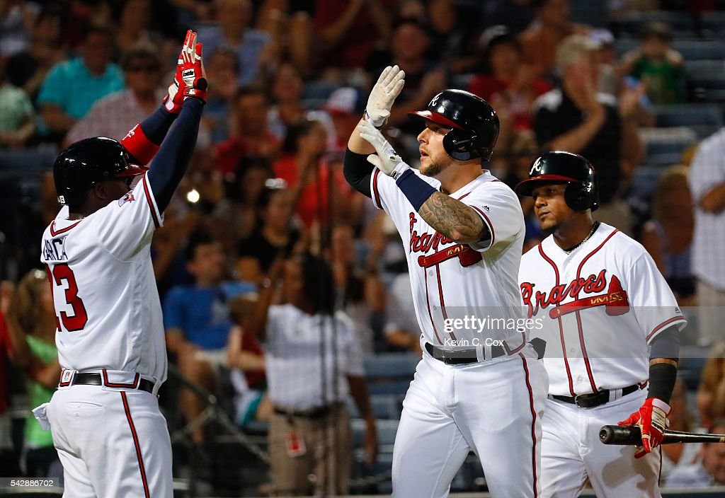 Brandon Snyder #19 of the Atlanta Braves reacts after hitting a three-run homer that also scored Erick Aybar #1 and Adonis Garcia #13 in the fifth inning against the New York Mets at Turner Field on June 24, 2016 in Atlanta, Georgia.