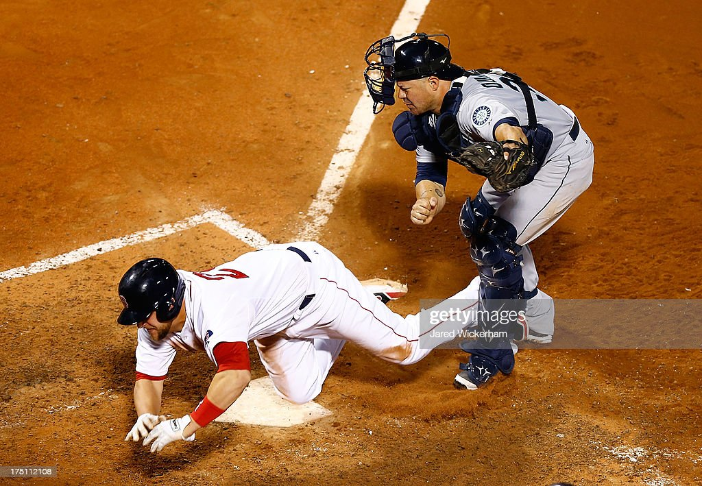 Brandon Snyder #23 of the Boston Red Sox is tagged out at home plate by <a gi-track='captionPersonalityLinkClicked' href=/galleries/search?phrase=Humberto+Quintero&family=editorial&specificpeople=226980 ng-click='$event.stopPropagation()'>Humberto Quintero</a> #35 of the Seattle Mariners during the game on July 31, 2013 at Fenway Park in Boston, Massachusetts.