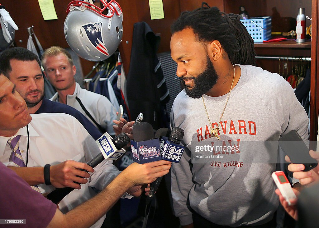 Brandon Spikes talks to the media in the locker room after practice. The New England Patriots held practice on the practice fields at Gillette Stadium.