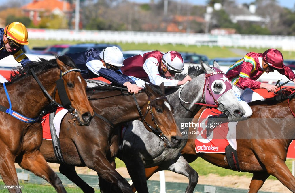 Brandon Stockdale riding Rhythm To Spare (L) wins from Ben Melham riding Foundry ,Michael Dee riding Moonovermanhattan and Regan Baylis riding Jacquinot Bay in Race 4 during Melbourne Racing at Caulfield Racecourse on August 19, 2017 in Melbourne, Australia.