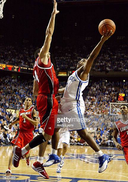 Brandon Stockton of the Kentucky Wildcats attempts a shot against Luke Whitehead of the Louisville Cardinals during Louisville's 6556 win over...