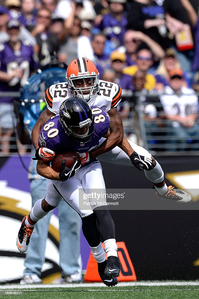 Brandon Stokley #80 of the Baltimore Ravens is tackled by Buster Skrine #22 of the Cleveland Browns after catching a pass during the second half of a game at M&T Bank Stadium on September 15, 2013 in Baltimore, Maryland.