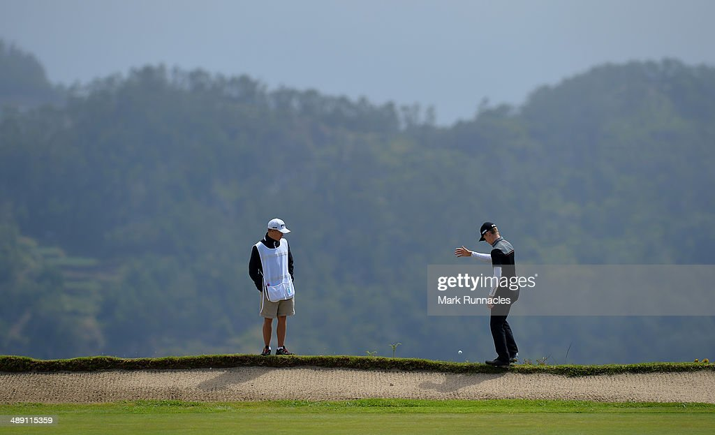 Brandon Stone of Republic of South Africa has to drop a ball at the back of the 4th green during the Madeira Islands Open - Portugal - BPI at Club de Golf do Santo da Serra on May 10, 2014 in Funchal, Madeira, Port gal.