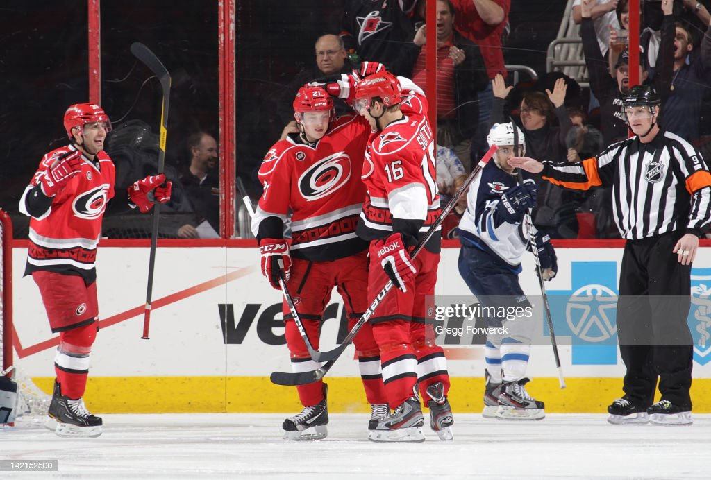 Brandon Sutter #16 of the Carolina Hurricanes celebrates his second period goal with assists by Drayson Bowman #21 and Patrick Dwyer #39 during an NHL game against the Winnipeg Jets on March 30, 2012 at PNC Arena in Raleigh, North Carolina.