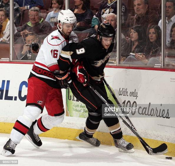 Brandon Sutter of the Carolina Hurricanes reaches around for the puck against Bobby Ryan of the Anaheim Ducks during the game on November 25 2009 at...