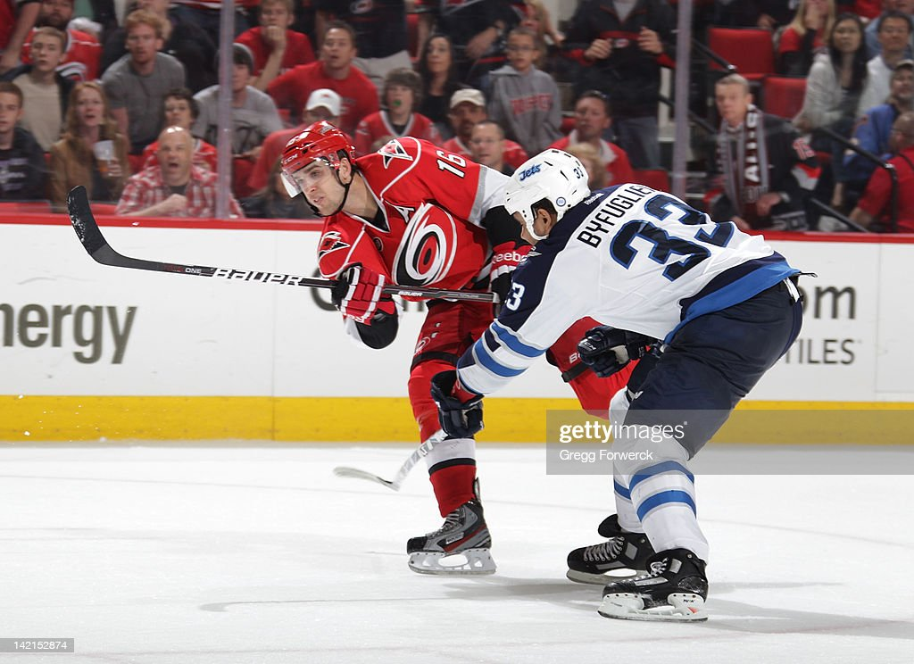 Brandon Sutter #16 of the Carolina Hurricanes shoots the puck against the Winnipeg Jets during an NHL game on March 30, 2012 at PNC Arena in Raleigh, North Carolina.