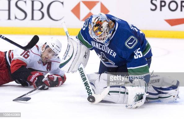 Brandon Sutter of the Carolina Hurricanes watches goalie Cory Schneider of the Vancouver Canucks stop his shot during the first period in NHL action...