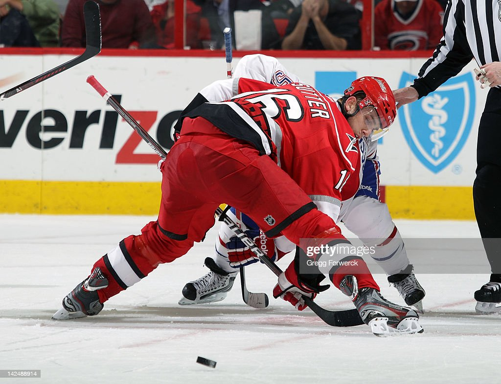 Brandon Sutter #16 of the Carolina Hurricanes wins a faceoff against <a gi-track='captionPersonalityLinkClicked' href=/galleries/search?phrase=David+Desharnais&family=editorial&specificpeople=4084305 ng-click='$event.stopPropagation()'>David Desharnais</a> #51 of the Montreal Canadiens during an NHL game on Apri 5, 2012 at PNC Arena in Raleigh, North Carolina.