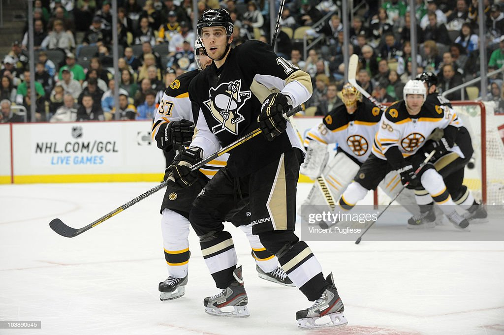 <a gi-track='captionPersonalityLinkClicked' href=/galleries/search?phrase=Brandon+Sutter&family=editorial&specificpeople=2086411 ng-click='$event.stopPropagation()'>Brandon Sutter</a> # 16 of the Pittsburgh Penguins attempts to deflect a puck during the third period against the Boston Bruins on February 17, 2013 at the CONSOL Energy Center in Pittsburgh, Pennsylvania.