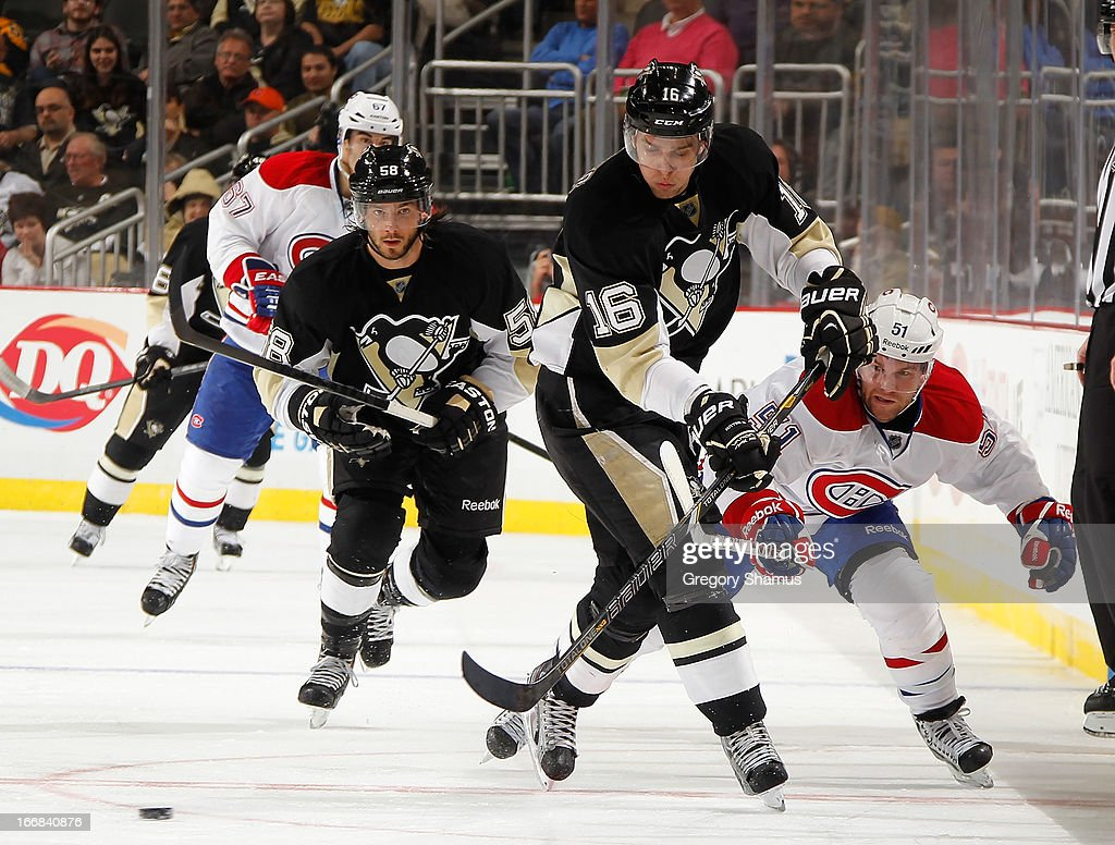 <a gi-track='captionPersonalityLinkClicked' href=/galleries/search?phrase=Brandon+Sutter&family=editorial&specificpeople=2086411 ng-click='$event.stopPropagation()'>Brandon Sutter</a> #16 of the Pittsburgh Penguins battles for the puck against <a gi-track='captionPersonalityLinkClicked' href=/galleries/search?phrase=David+Desharnais&family=editorial&specificpeople=4084305 ng-click='$event.stopPropagation()'>David Desharnais</a> #51 of the Montreal Canadiens on April17, 2013 at Consol Energy Center in Pittsburgh, Pennsylvania. Pittsburgh won the game 6-4.