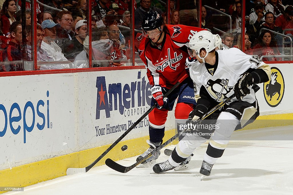 <a gi-track='captionPersonalityLinkClicked' href=/galleries/search?phrase=Brandon+Sutter&family=editorial&specificpeople=2086411 ng-click='$event.stopPropagation()'>Brandon Sutter</a> #16 of the Pittsburgh Penguins battles for the puck against John Carlson #74 of the Washington Capitals in the third period during an NHL game at Verizon Center on March 10, 2014 in Washington, DC.