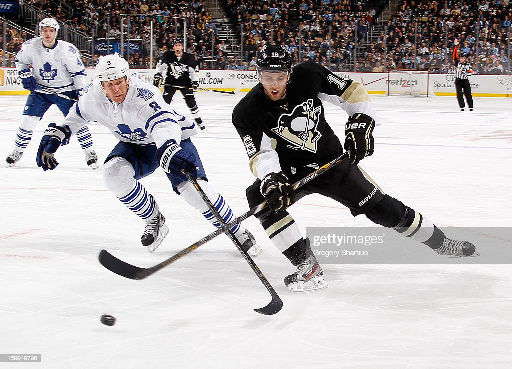 Brandon Sutter #16 of the Pittsburgh Penguins battles for the puck against <a gi-track='captionPersonalityLinkClicked' href=/galleries/search?phrase=Mike+Komisarek&family=editorial&specificpeople=213814 ng-click='$event.stopPropagation()'>Mike Komisarek</a> #8 of the Toronto Maple Leafs on January 23, 2013 at Consol Energy Center in Pittsburgh, Pennsylvania. Toronto won the game 5-2.