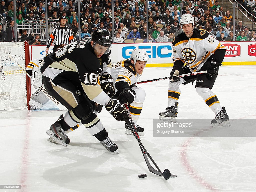 <a gi-track='captionPersonalityLinkClicked' href=/galleries/search?phrase=Brandon+Sutter&family=editorial&specificpeople=2086411 ng-click='$event.stopPropagation()'>Brandon Sutter</a> #16 of the Pittsburgh Penguins battles for the puck against <a gi-track='captionPersonalityLinkClicked' href=/galleries/search?phrase=Andrew+Ference&family=editorial&specificpeople=202264 ng-click='$event.stopPropagation()'>Andrew Ference</a> #21 of the Boston Bruins on March 17, 2013 at Consol Energy Center in Pittsburgh, Pennsylvania. Pittsburgh won the game 2-1.