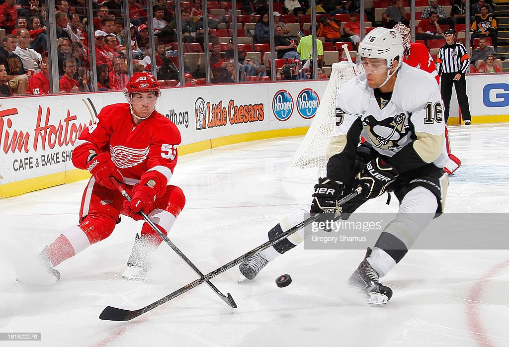 Brandon Sutter #16 of the Pittsburgh Penguins battles for the puck with Adam Almquist #53 of the Detroit Red Wings in the third period during a pre season game at Joe Louis Arena on September 25, 2013 in Detroit, Michigan. The Penguins won the game 5-1.