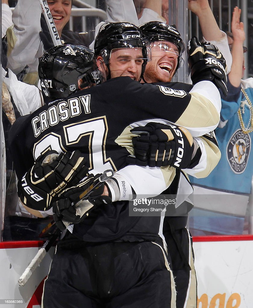 <a gi-track='captionPersonalityLinkClicked' href=/galleries/search?phrase=Brandon+Sutter&family=editorial&specificpeople=2086411 ng-click='$event.stopPropagation()'>Brandon Sutter</a> #16 of the Pittsburgh Penguins celebrates his game-winning goal with <a gi-track='captionPersonalityLinkClicked' href=/galleries/search?phrase=Sidney+Crosby&family=editorial&specificpeople=212781 ng-click='$event.stopPropagation()'>Sidney Crosby</a> #87 and <a gi-track='captionPersonalityLinkClicked' href=/galleries/search?phrase=James+Neal&family=editorial&specificpeople=1487991 ng-click='$event.stopPropagation()'>James Neal</a> #18 during the third period against the Boston Bruins on March 12, 2013 at Consol Energy Center in Pittsburgh, Pennsylvania. Pittsburgh won the game 3-2.