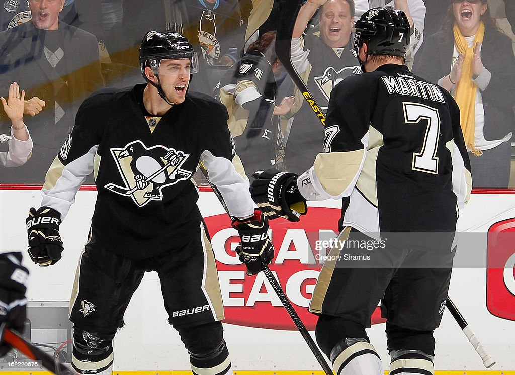<a gi-track='captionPersonalityLinkClicked' href=/galleries/search?phrase=Brandon+Sutter&family=editorial&specificpeople=2086411 ng-click='$event.stopPropagation()'>Brandon Sutter</a> #16 of the Pittsburgh Penguins celebrates his goal with Paul Martin #7 during the third period against the Philadelphia Flyers on February 20, 2013 at Consol Energy Center in Pittsburgh, Pennsylvania. Philadelphia won the game 6-5.