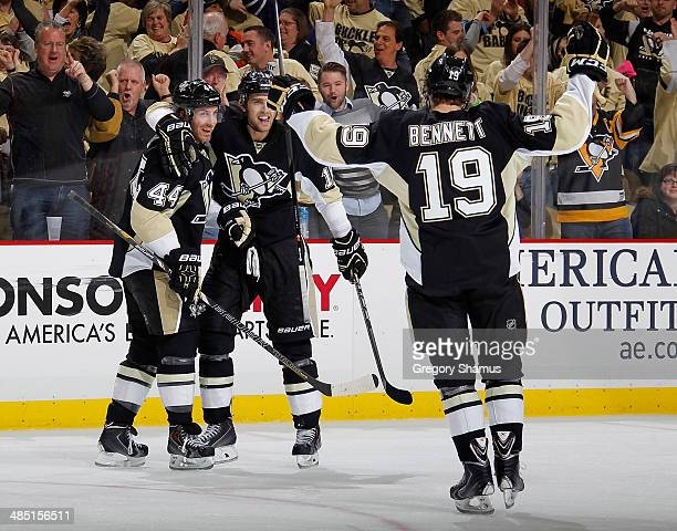 Brandon Sutter of the Pittsburgh Penguins celebrates his goal with Brooks Orpik and Beau Bennett during the third period against the Columbus Blue...