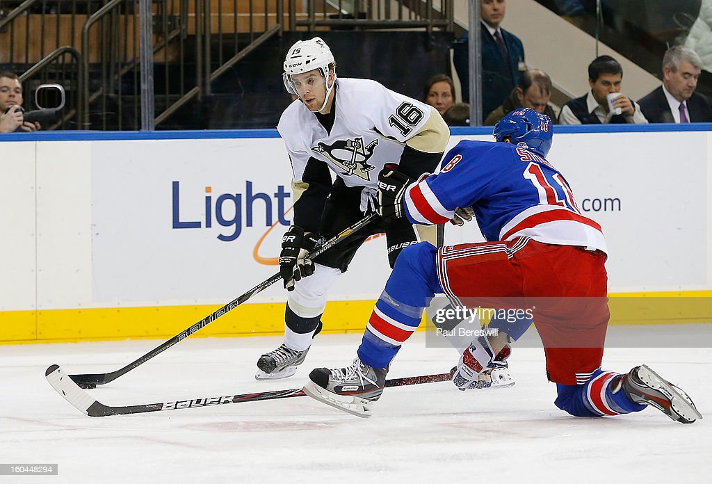 <a gi-track='captionPersonalityLinkClicked' href=/galleries/search?phrase=Brandon+Sutter&family=editorial&specificpeople=2086411 ng-click='$event.stopPropagation()'>Brandon Sutter</a> #16 of the Pittsburgh Penguins controls the puck against <a gi-track='captionPersonalityLinkClicked' href=/galleries/search?phrase=Marc+Staal&family=editorial&specificpeople=3809026 ng-click='$event.stopPropagation()'>Marc Staal</a> #18 of the New York Rangers in the third period of an NHL hockey game at Madison Square Garden on January 31, 2013 in New York City.