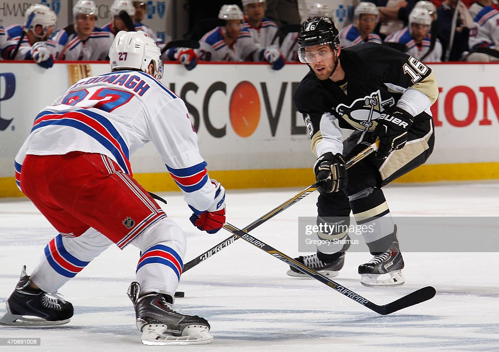 Brandon Sutter of the Pittsburgh Penguins controls the puck in front of Ryan McDonagh of the New York Rangers in Game Four of the Eastern Conference...