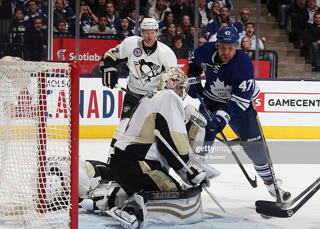 Brandon Sutter of the Pittsburgh Penguins lies on the ice after being hit with a puck during the third period against the Toronto Maple Leafs at the...