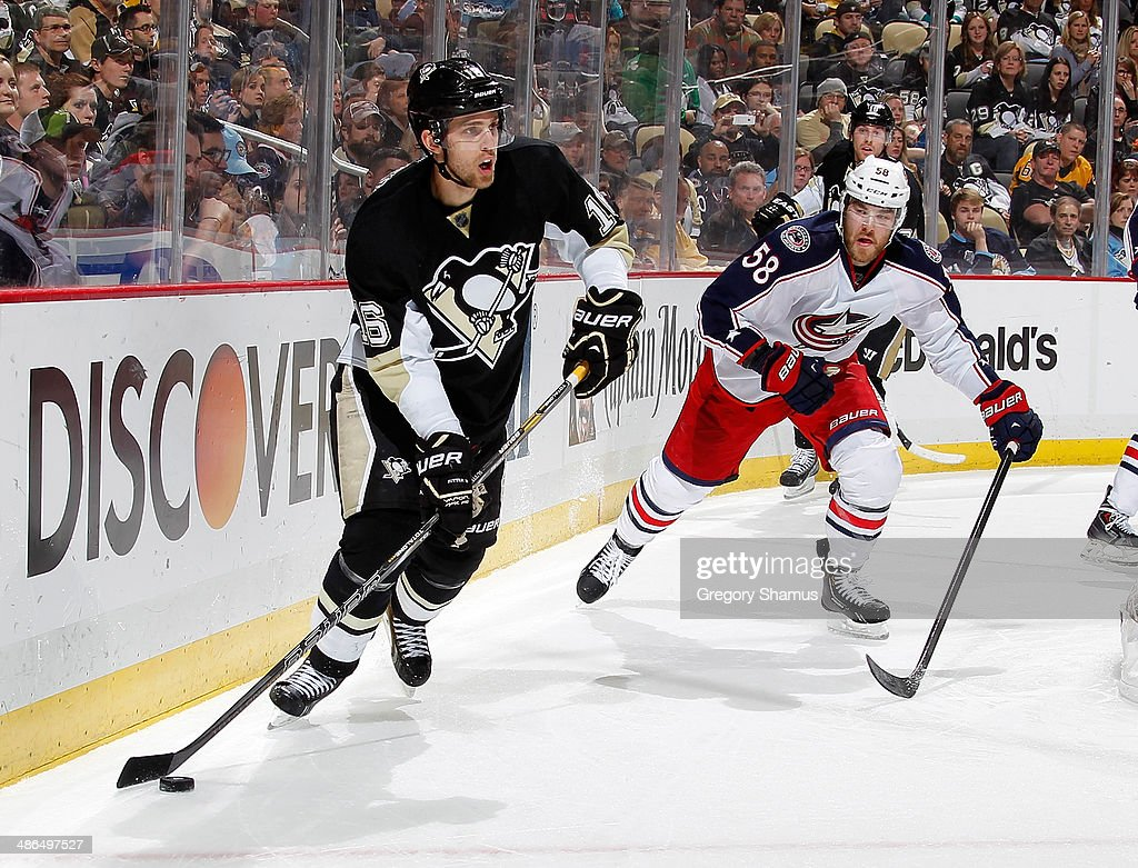 <a gi-track='captionPersonalityLinkClicked' href=/galleries/search?phrase=Brandon+Sutter&family=editorial&specificpeople=2086411 ng-click='$event.stopPropagation()'>Brandon Sutter</a> #16 of the Pittsburgh Penguins moves the puck in front of <a gi-track='captionPersonalityLinkClicked' href=/galleries/search?phrase=David+Savard&family=editorial&specificpeople=4630692 ng-click='$event.stopPropagation()'>David Savard</a> #58 of the Columbus Blue Jackets in Game Two of the First Round of the 2014 Stanley Cup Playoffs at Consol Energy Center on April 19, 2014 in Pittsburgh, Pennsylvania.